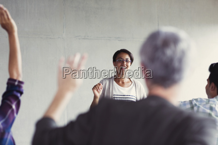 teacher calling on students with hands