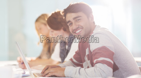 university student smiling in classroom