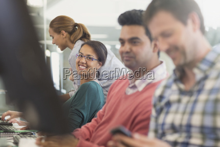 portrait confident woman at computer in