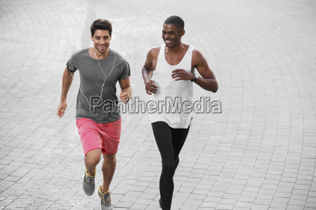 men running through city streets together
