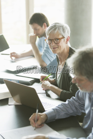 portrait confident senior woman studying in