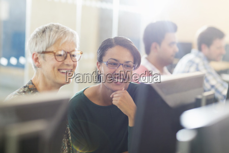 smiling women at computer in adult