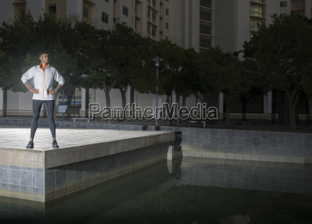 man standing in city park at