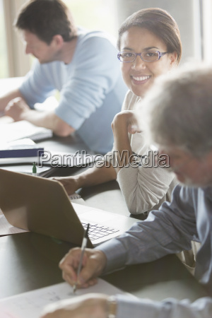 portrait smiling woman studying in adult