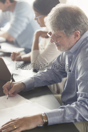 man doing homework in adult education