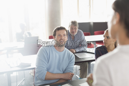 professor and students talking in adult
