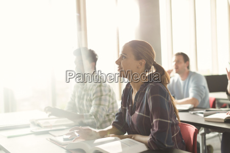attentive students listening in adult education