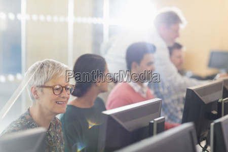 senior woman at computer in adult