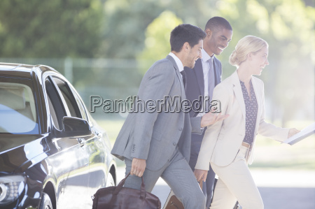 business people walking together on city