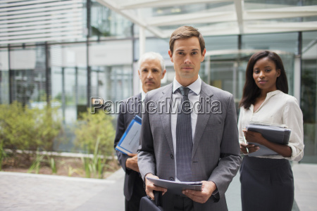 business people outside of office building