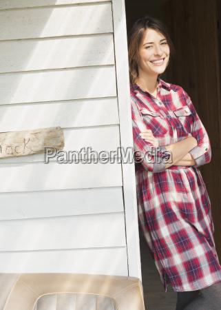 portrait smiling brunette woman in plaid