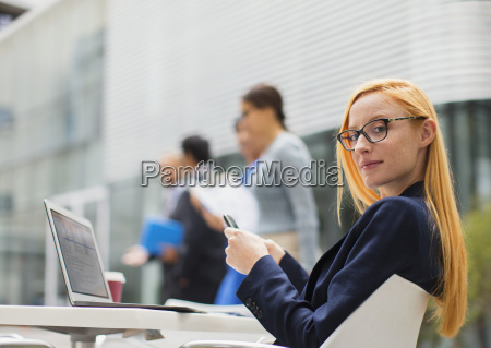 businesswoman working at table outside of