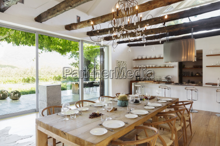 chandelier over dining table in modern