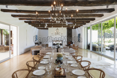 chandelier over dining table in luxury