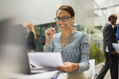 businesswoman at desk talking on headset