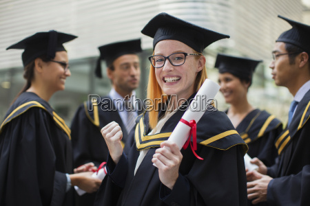 student in cap and gown celebrating