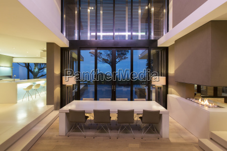 modern dining room with fireplace and