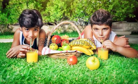 boys drinking juice