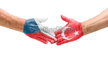 football teams handshake between the czech