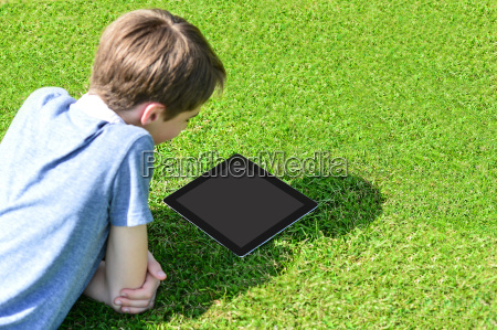 boy with tablet pc outdoors