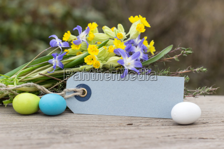 spring flowers with easter eggs and
