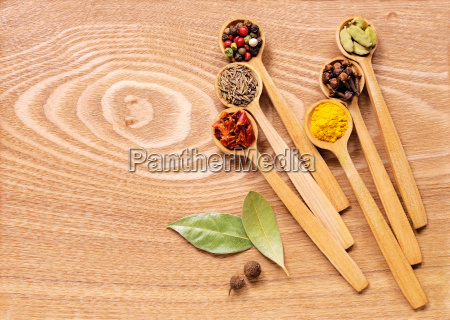 set of several spices in wooden