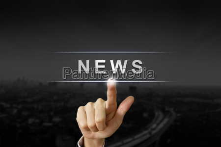 business hand pushing news button on