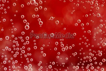 rot abstrakten hintergrund mit wassertropfen