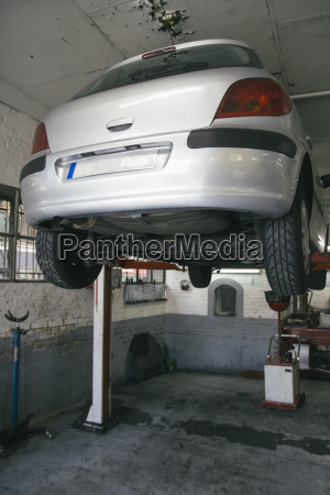 car on hoist in a workshop
