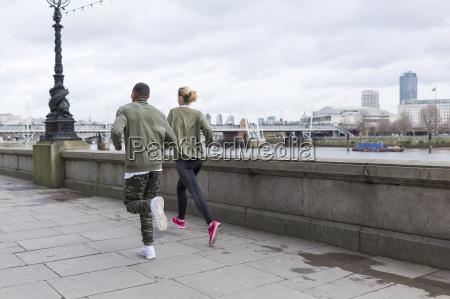 uk london man and woman running