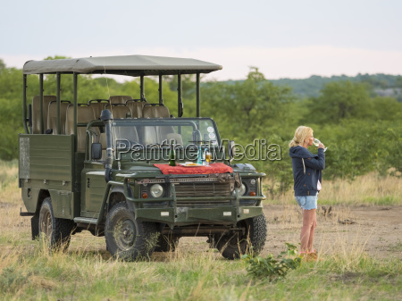 namibia outjo tourist drinking glass of
