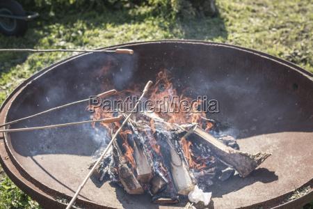 germany brandenburg children roasting sausages at