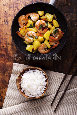 frying pan of prawns with pineapple