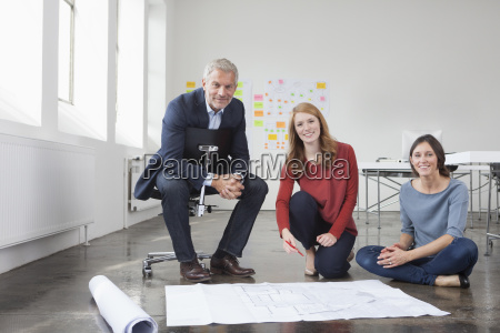 portrait of smiling businessman and two