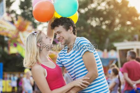 happy couple at fun fair