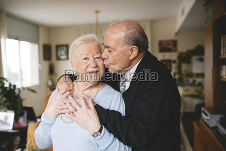 senior couple hugging and kissing at