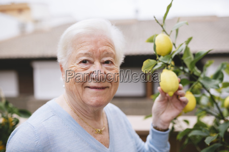 portrait of happy senior woman holding