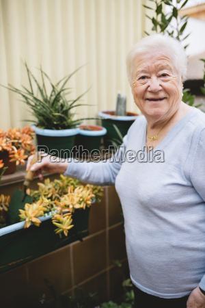 portrait of smiling senior woman gardening