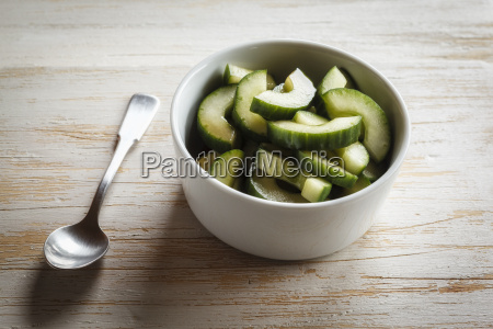 cucumber salad in bowl spoon