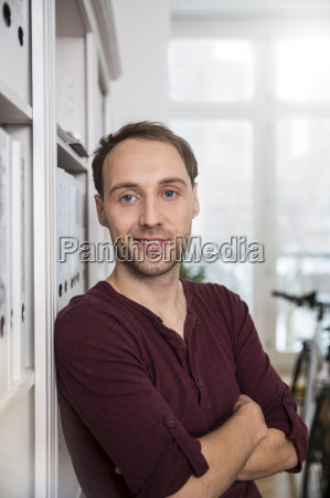 portrait of confident man in office