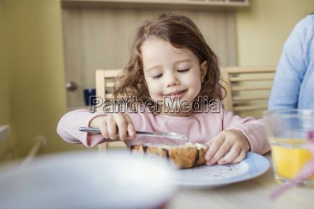 portrait of smiling little girl spreading