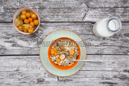bowl with cereals and physalis milk