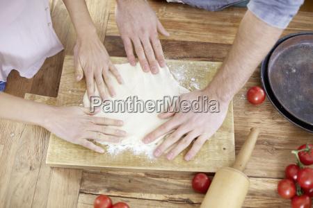 couple preparing yeast dough