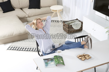 woman relaxing with feet up on