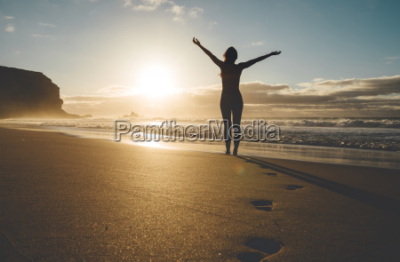 woman standing on the beach with