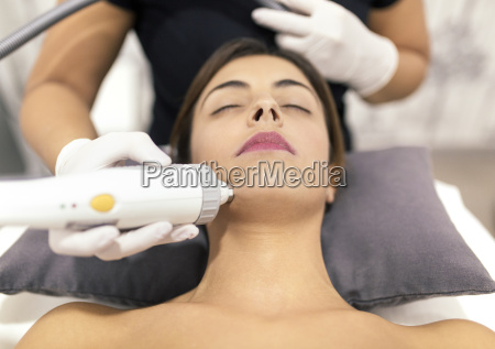 young woman receiving a beauty treatment