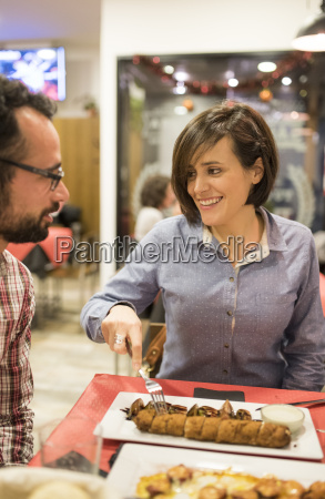 couple eating in a spanish bar