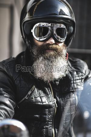 portrait of bearded biker wearing black