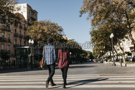 spain tarragona young couple walking in