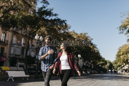spain tarragona young couple walking in